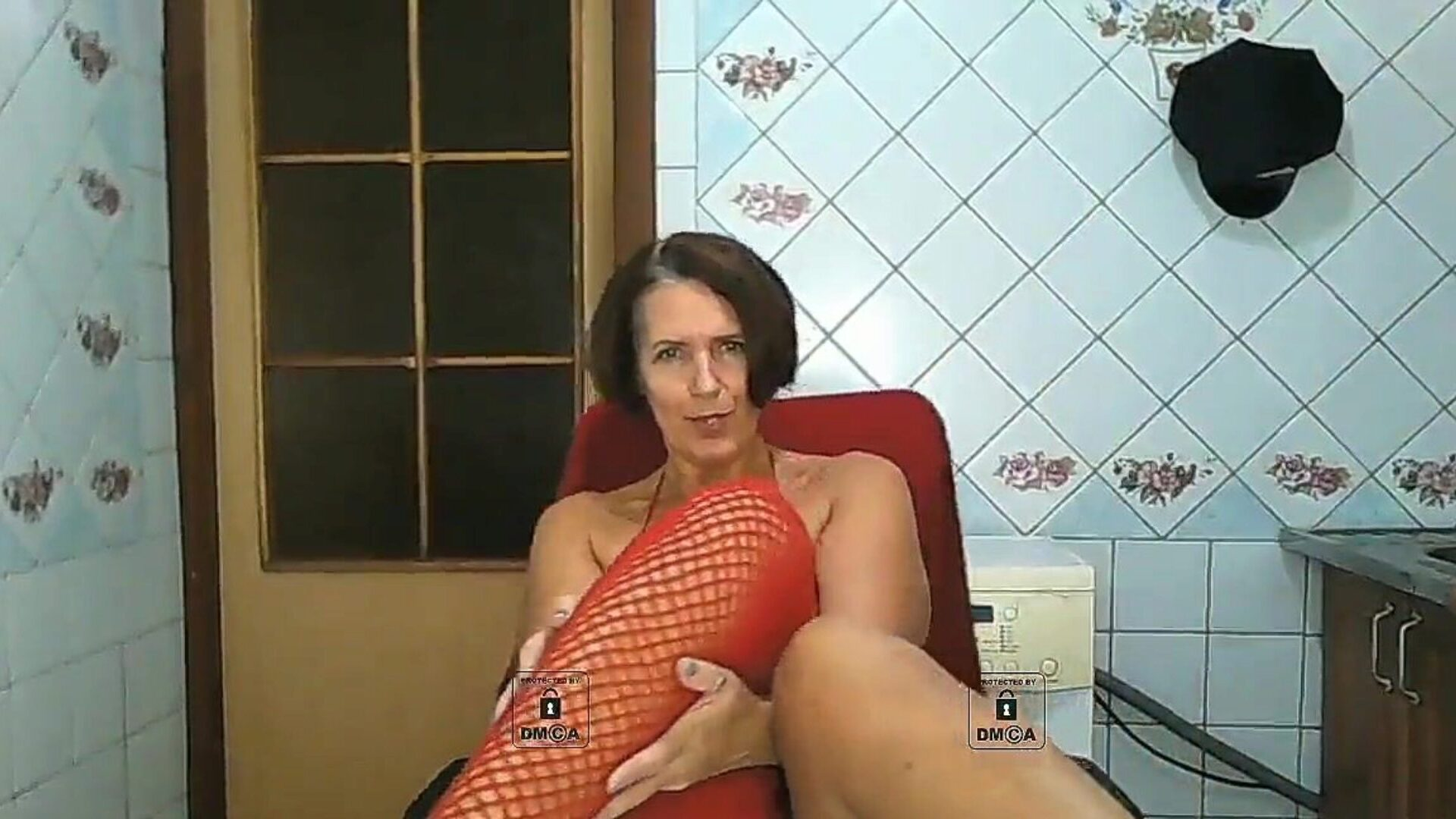 Attractive grandma with bare zeppelins in red Attractive older chick misses hookup and talking on webcam Shows a aged hot body wiggles her a-hole munches naked marangos in red fishnet panties and nylons