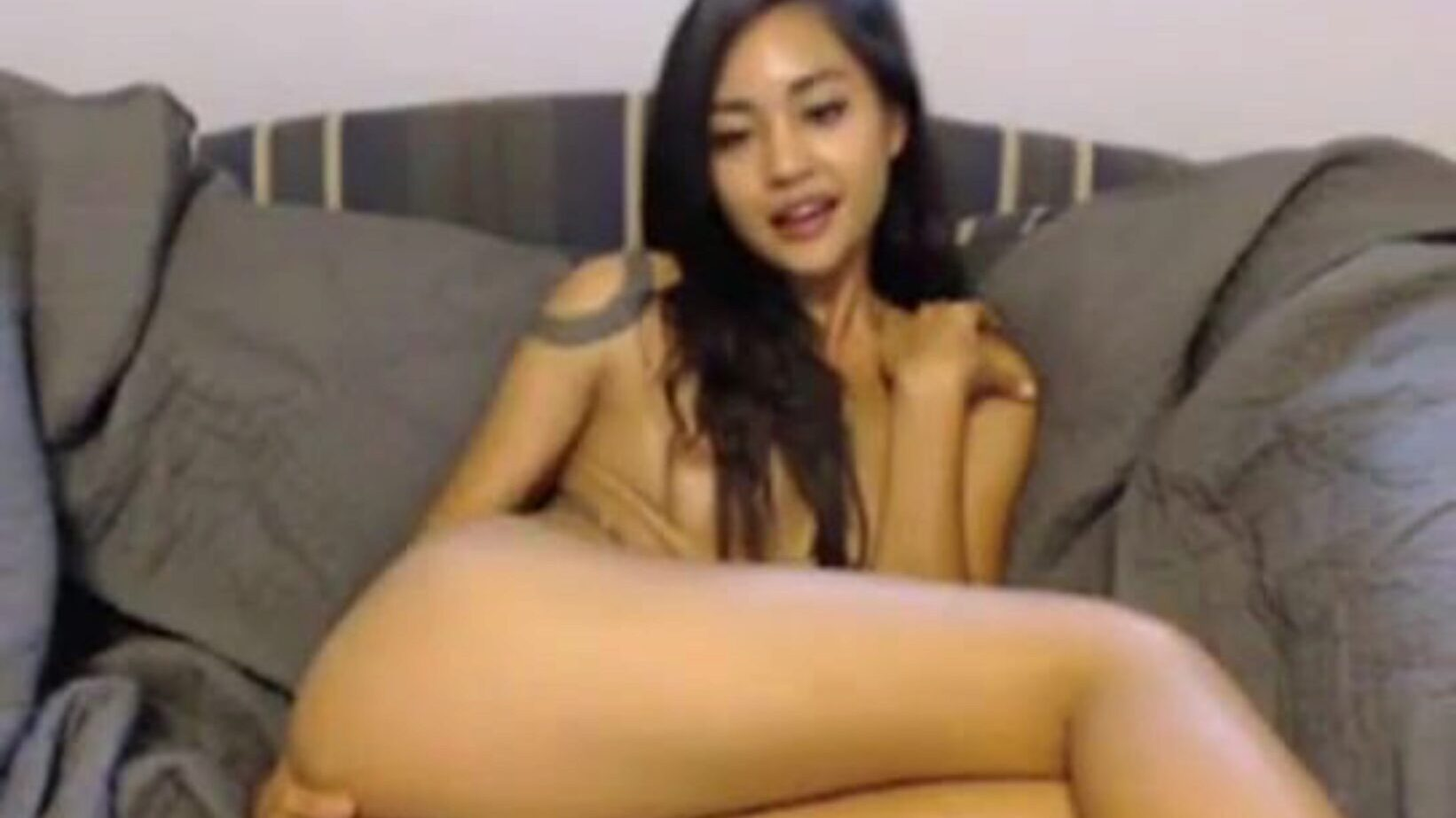 Naughty Asian Teen With A Dildo